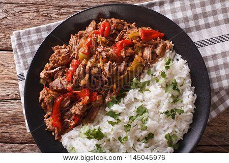 Cuban Cuisine: Ropa Vieja Meat With Rice Garnish  Closeup. Horizontal Top View