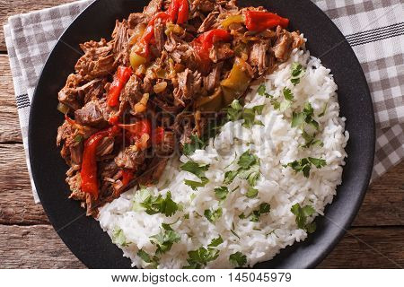 Latin American Cuisine: Ropa Vieja With Rice Close-up. Horizontal Top View