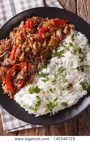Latin American Cuisine: Ropa Vieja With Rice Close-up. Vertical Top View