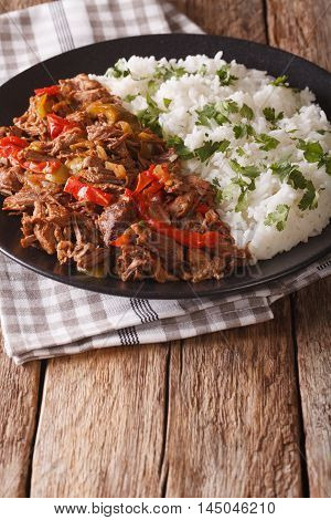 Mexican Food Ropa Vieja: Beef Stew In Tomato Sauce With Vegetables And Rice. Vertical