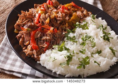 Ropa Vieja: Beef Stew In Tomato Sauce With Vegetables And Rice Garnish Macro. Horizontal
