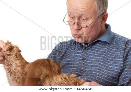 Bald Senior Man With Dog