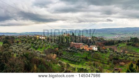 Landscape Tuscany, Italy with cloudy sky and historical typical building
