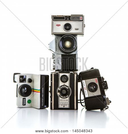 SWINDON UK - AUGUST 20 2016: Collection of old cameras on a white backbground