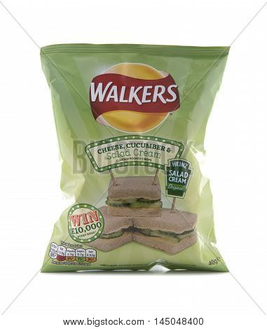 SWINDON UK - AUGUST 27 2016: A Bag of Walkers Cheese Cucumber and Salad Cream Flavour crisps isolated on a white background. Walkers is a British snack food manufacturer