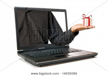 Hand with a gift come out from a screen of a laptop computer isolated on white background.