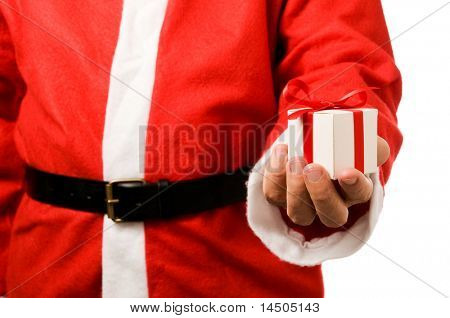 Santa Claus holding and offering a gift on his hand isolated on white background.