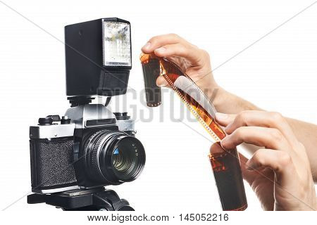 Photographer With Color Negative Film Near Slr Camera Isolated