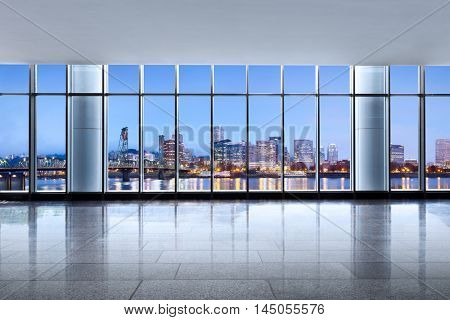 cityscape and skyline of portland at sunrise from glass window