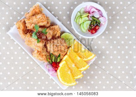 Fried tofu nuggets with minced shrimp and pork on gray background.