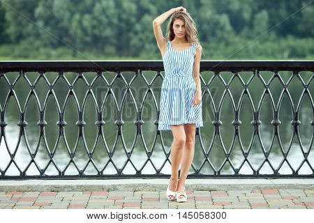 Full Length Portrait Young Beautiful Woman In White Blue Striped Dress, Summer Rver Park Outdoors