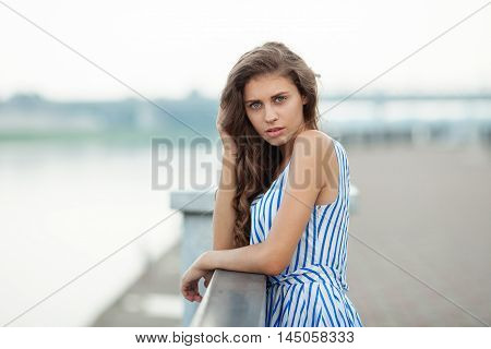 Closeup Portrait Of Beautiful Woman In Summer Dress Posing In City River Park Pier Enjoying Weekend.