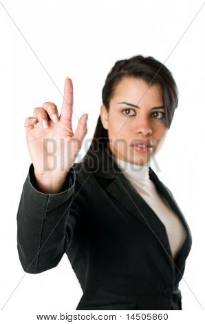 Young businesswoman pushing or poiting a transparent screen isolated on white background