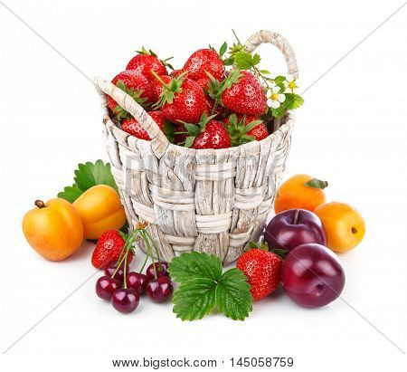 Berries healthy eating fruits harvest strawberries wicker basket still life. Isolated on white background
