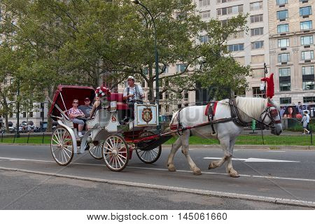 New York NY US -- August 31 2016. Tourists go on a horse and carriage ride in New York City. Editorial Use Only.