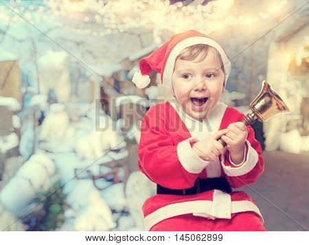 happy santa claus kid with ball
