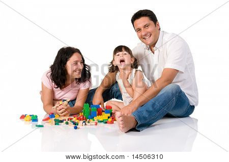 Happy family with parents and daughter playing with colorful blocks isolated on white background