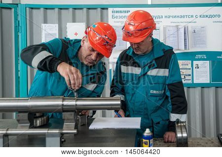 Tobolsk, Russia - July 15. 2016: Sibur company. Polymer plant. Mechanics carry out adjusting in the shop