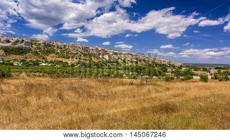 Rocks and grass of Crimean peninsula. Stock photo.