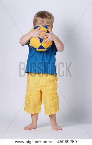 photo of little happy boy with swimming suit