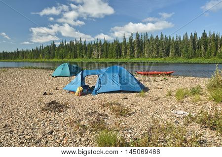 Kayak and tent on the river Bank. Parking travelers along the national Park Yugyd VA.