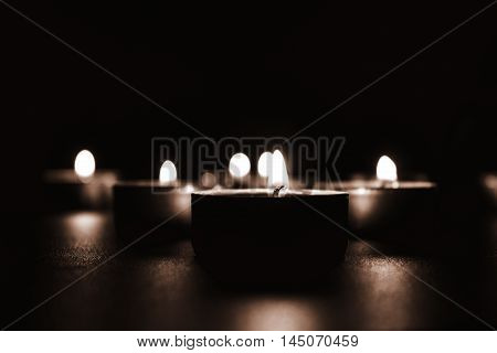 Candles in church. Selective focus on the candles flame