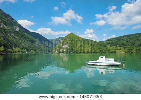 Perucac lake view and boat in Tara National Park, Serbia