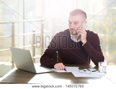 Lawyer working with laptop in office