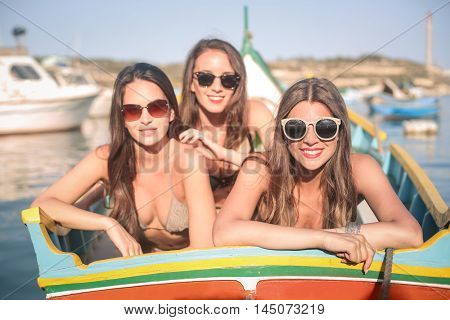 Three girls on vacation in a summer day
