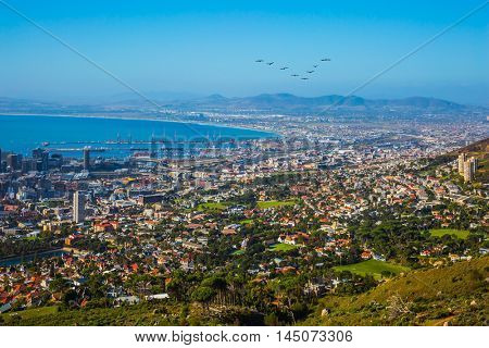 Concept of active tourism and rest. Travel to Africa. Panorama Cape Town, photographed from top of the Table mountain