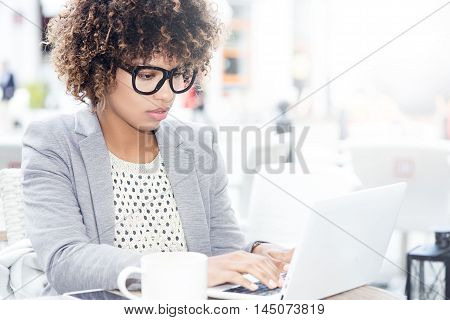 Elegant African American Woman Working On Laptop.