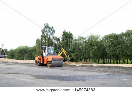 photo on roller for laying asphalt at work