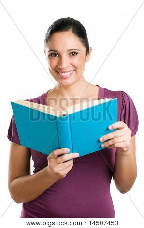 Beautiful young casual woman looking at camera while reading a book isolated on white background