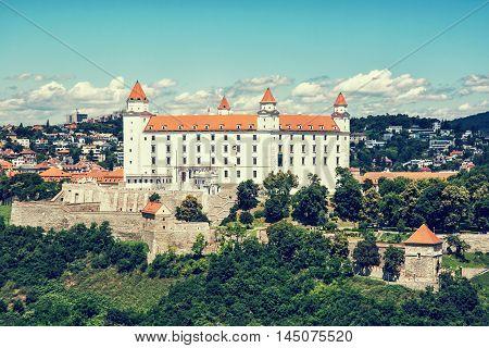 Bratislava castle in capital city of Slovak republic. Architectural theme. Cultural heritage. Travel destination. Blue retro photo filter. Seat of power.