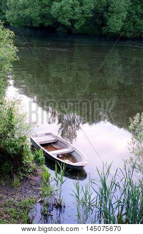 Boat by the river in the summer