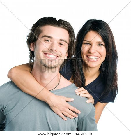 Happy smiling young latin couple piggyback isolated on white background