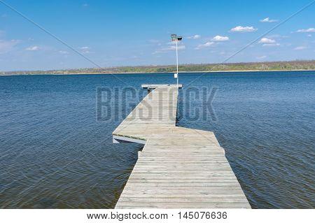 Empty wooden pier on Dnepr river in Ukraine
