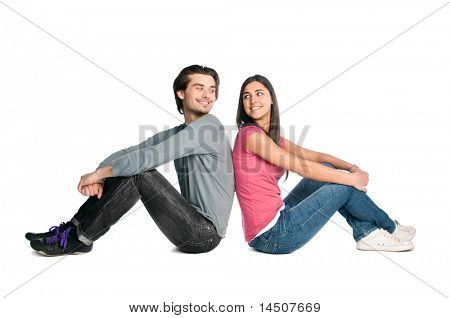 Smiling young couple looking each other with tenderness and love isolated on white background