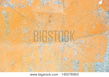 Orange background: metal surface with mint paint and creased texture