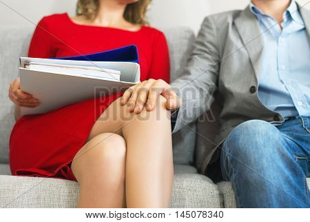 Sexual Harassment At Work. Man Touching Secretary's Knee.