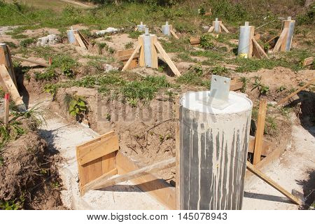 Building site. Foundations of a house. Concrete foundations of the house. Construction of a small family house.