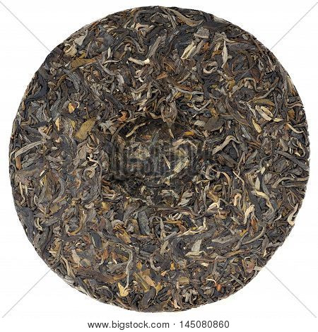 Myanmar raw puerh tea with stone impress overhead view isolated