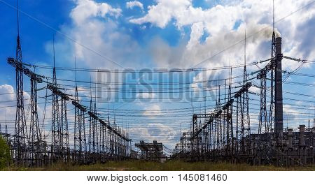 Electrical distribution station transformers electricity high-voltage lines.