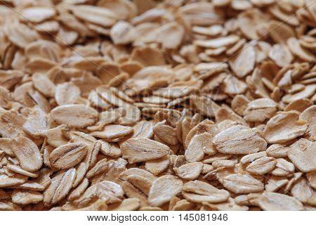 oatmeal grains photo, oat flakes, rolled oats, oat background. oatmeal photo, dry oatmeal