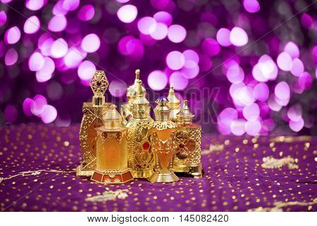 Eid and Ramadan theme backgrounds with perfume bottles and adornments and vibrant colored backgrounds