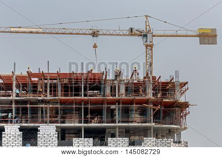 MANAMA, BAHRAIN - AUGUST 27, 2016: View of a Construction work on a high rise building site in the Capital City of the Kingdom.