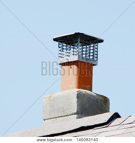 closeup chimney on the roof of sky background