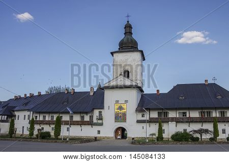 Neamt, Romania - April 30, 2014: Entrance gate and bell tower of medieval stone Neamt monastery Northeast Romania