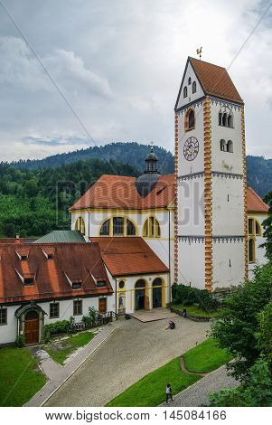 Clock Tower Of Hohes Schloss, Medieval Castle In The Middle Of Fussen Old Town, Bavarian Alps, Germa