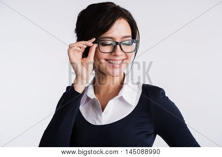 sexy young woman secretary wearing glasses on white background.